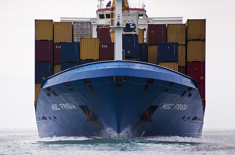 Bow and bow wave of container ship underway