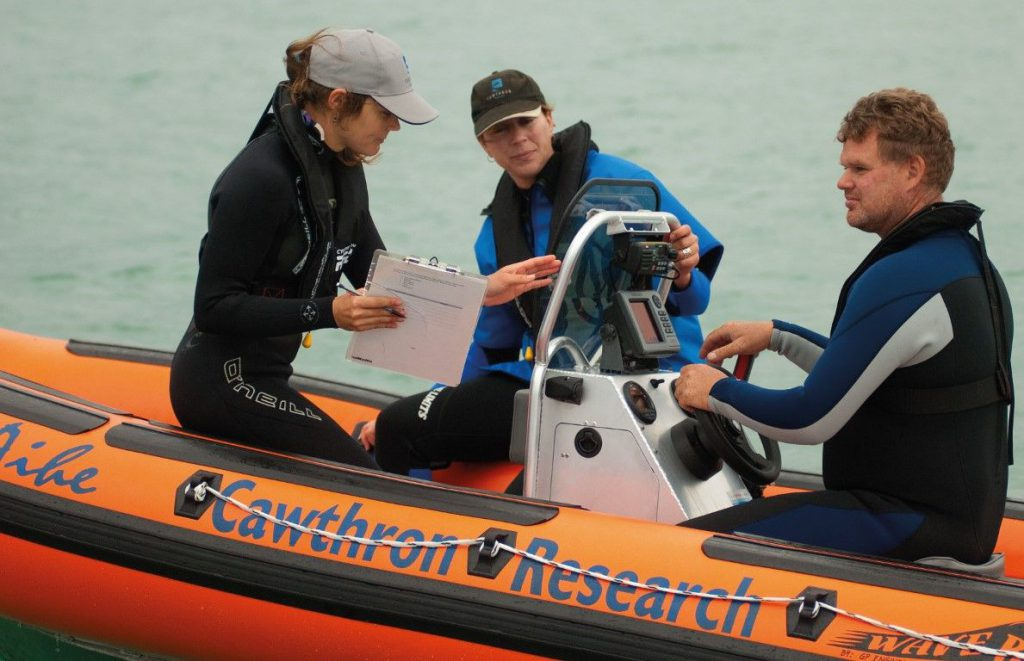 Dr Deanna Clement, middle, has been studying Hector's dolphins in Lyttelton Harbour.